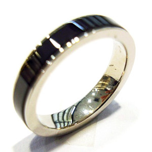 women's ring with ceramics and steel